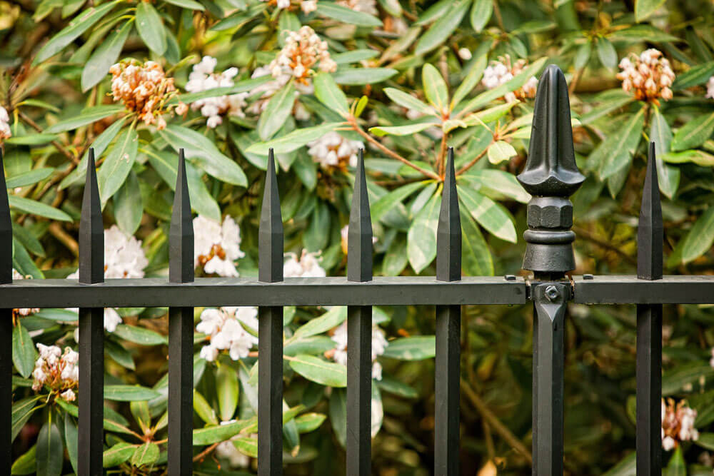 1927 Fence Replication close up with flowers