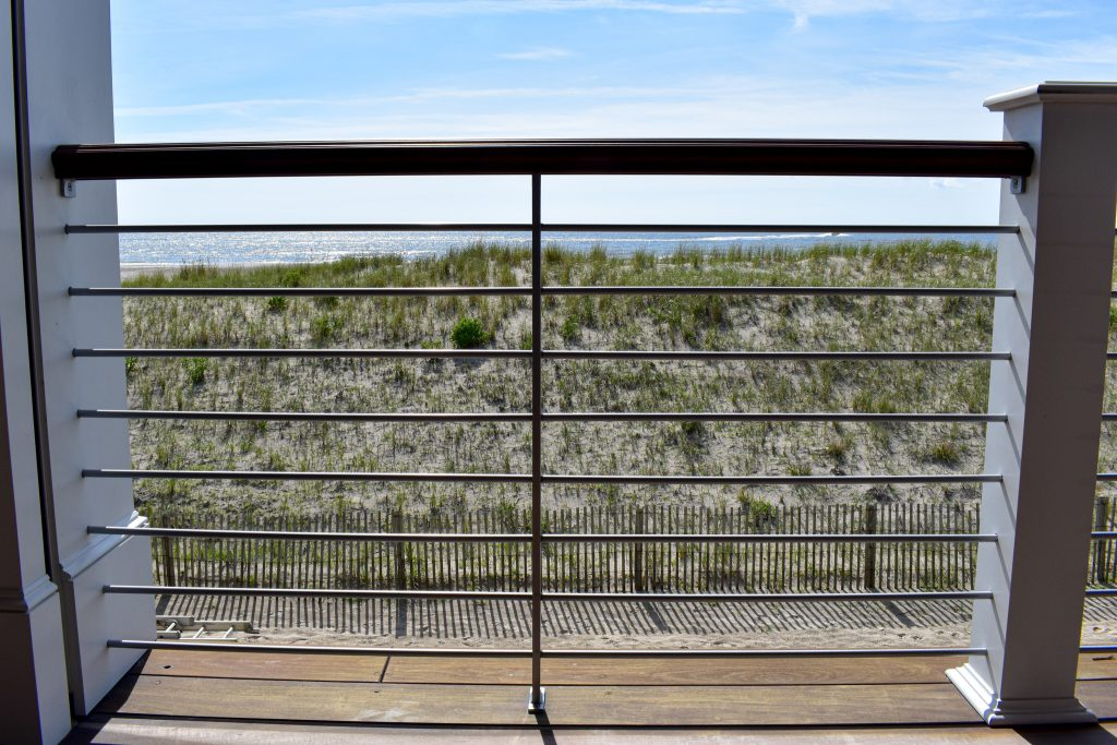 The homeowners wanted a very minimalistic modern railing design created for their shore front terrace.