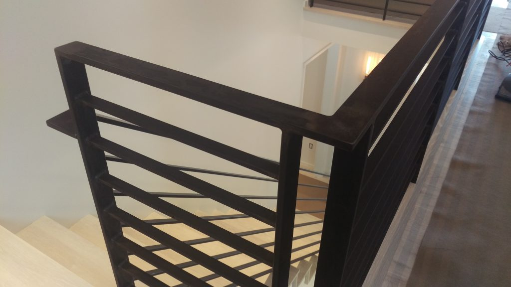 Contemporary Railing with Traditional Iron Material and Traditional Blackened Finish