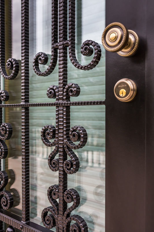 Forged Scroll Work on Security Door