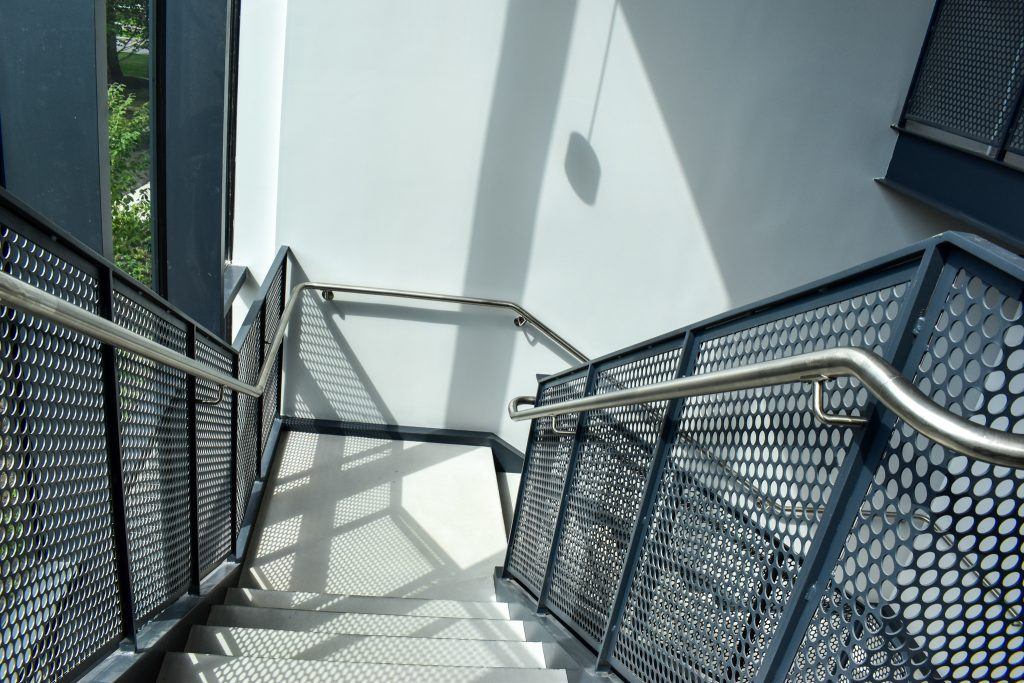 These monumental stairs elevated a normal commercial stair tower from ordinary to extraordinary.