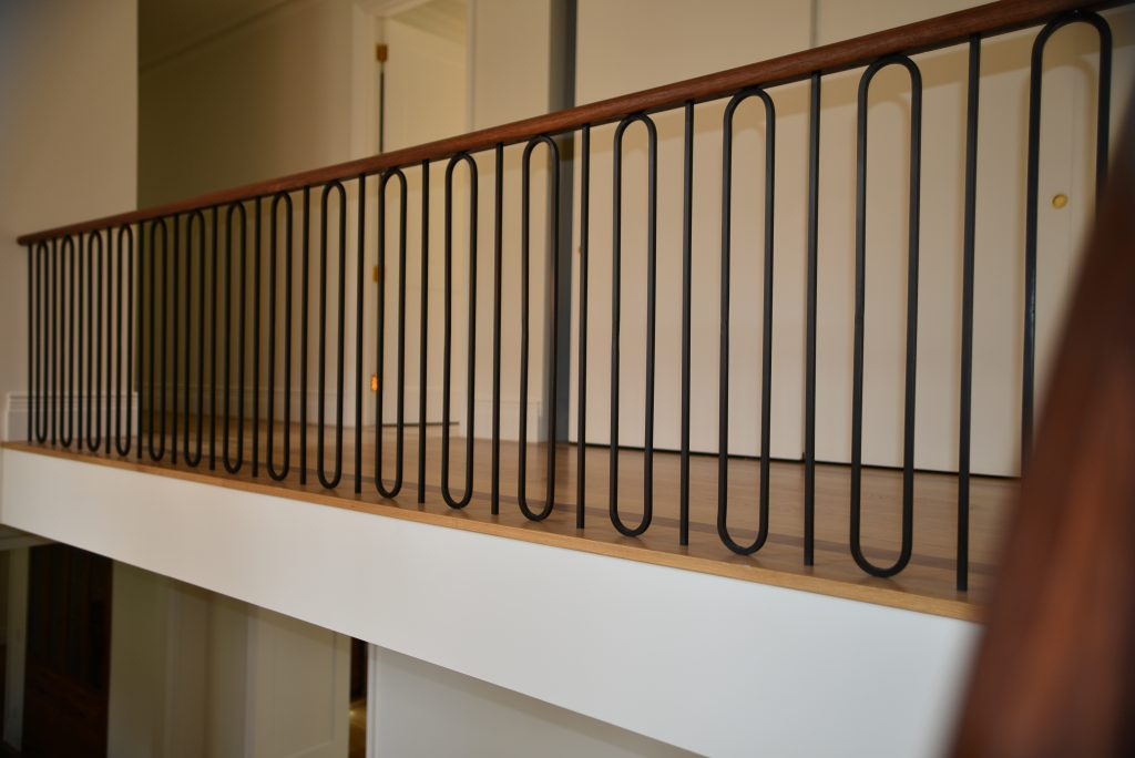 Modern Railing Design Installed Into Tread and Floor