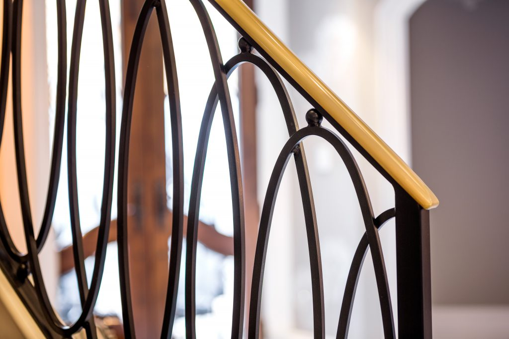 The beautiful contrast of bronze caprail on Iron Railing