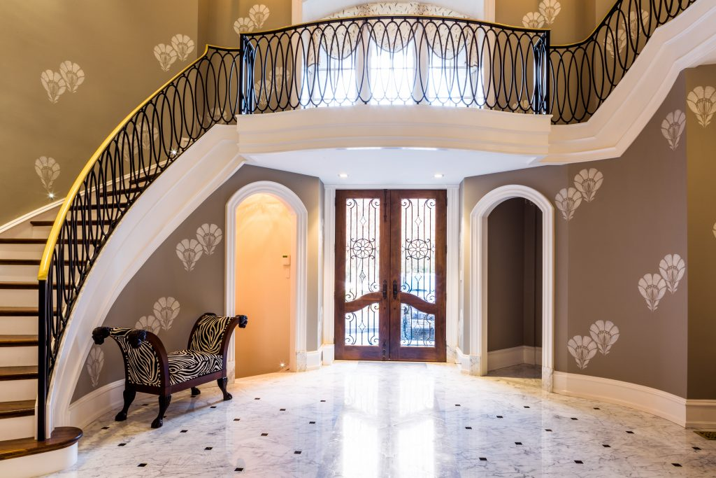 Transitional Stair railing design with bronze caprail