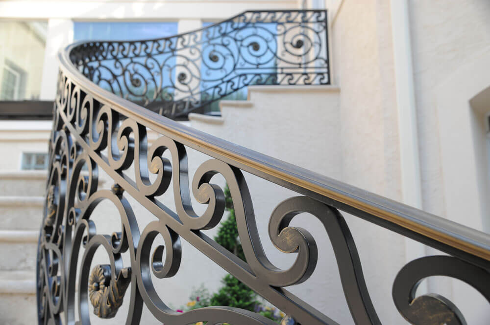 Custom Forged Railing with Bronze Caprail