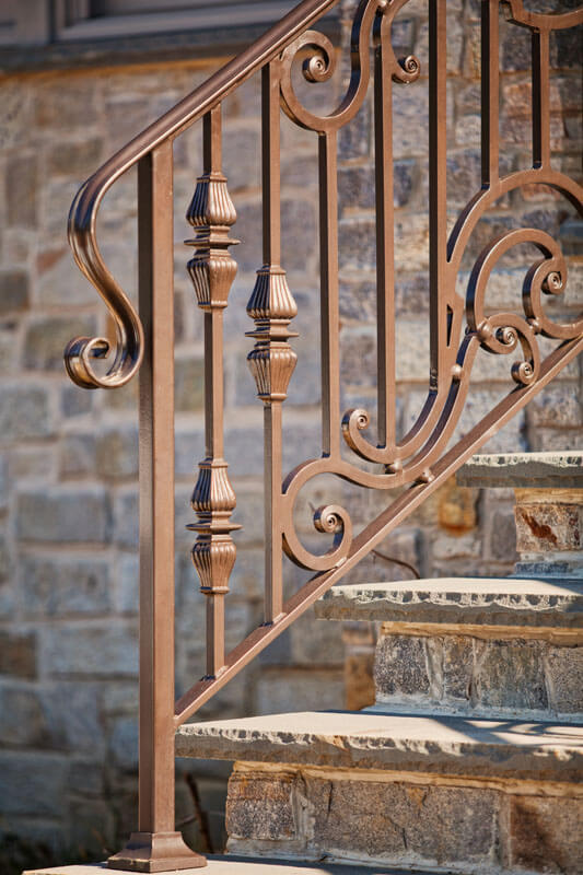 Bold Knuckle and Scroll Railing Design