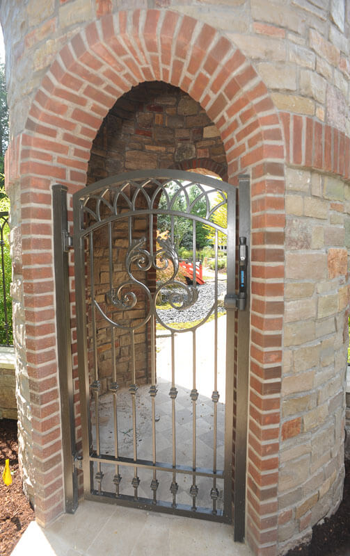 Pedestrian Fence Integrated into Brick Opening