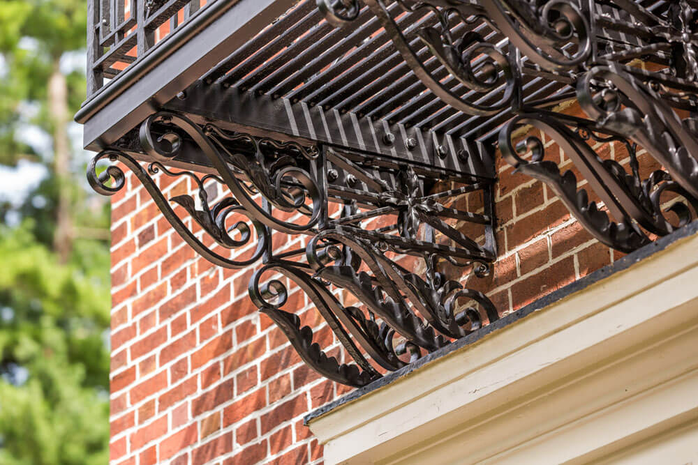 Custom Scroll Bracketry on Restored Iron Balcony Railing