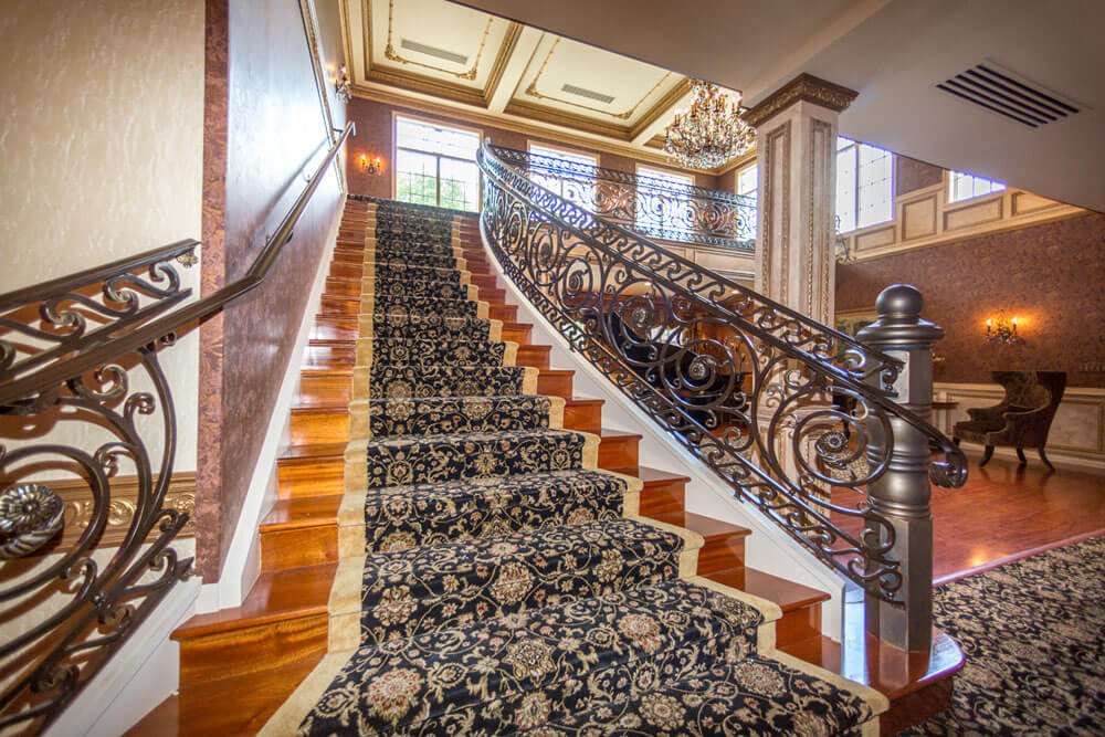 Custom Forged Iron Railing Accents Beautiful Stairset