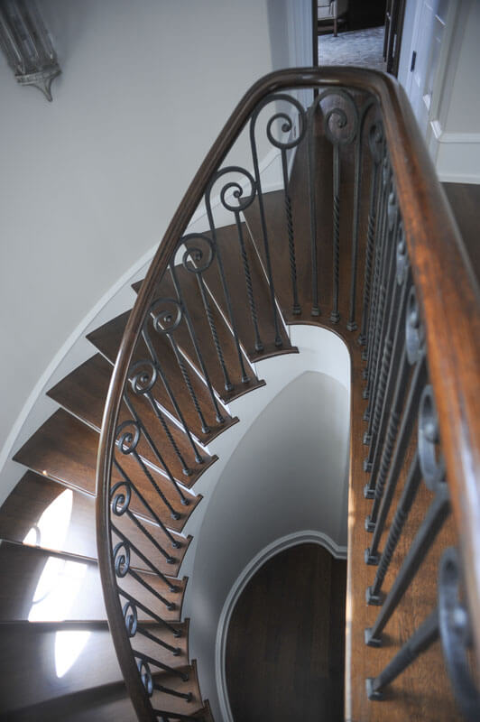 Custom Scrolled Iron Railing Mounted on Stair Treads
