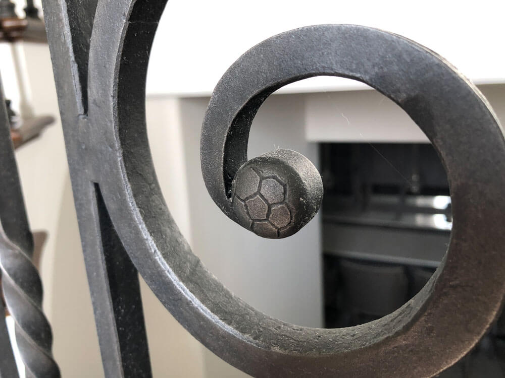 Custom Forged Soccer Ball Detail on Iron Railing
