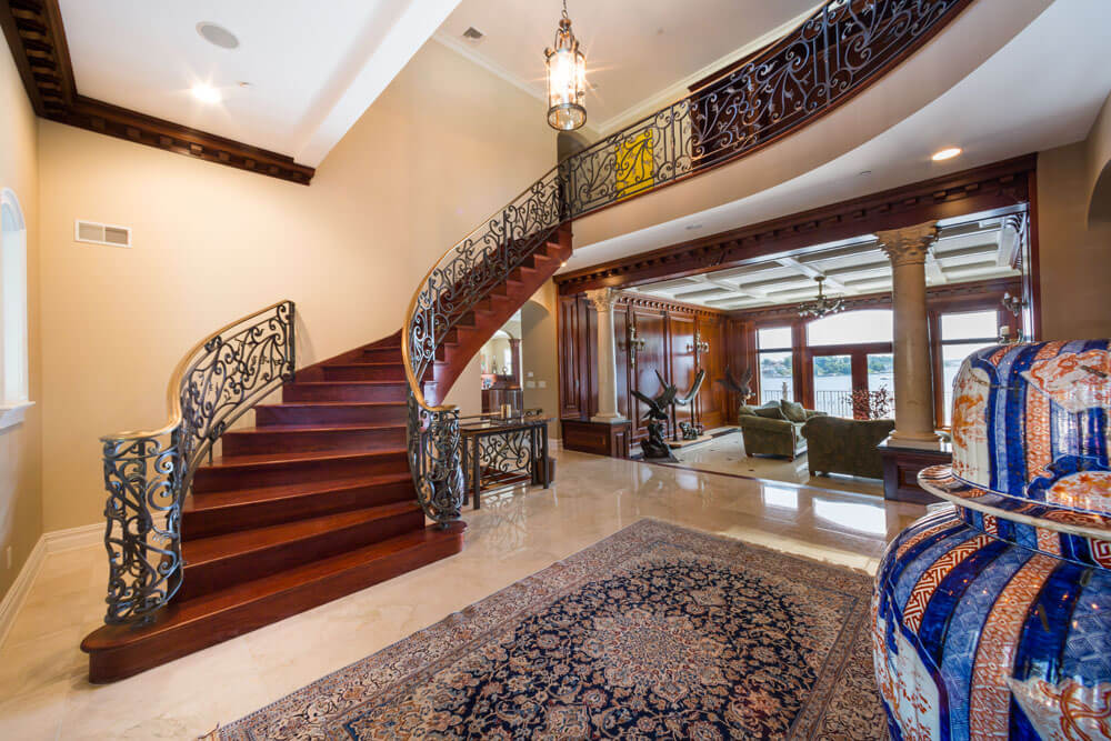 Custom Forged Iron Railing with Bronze Caprail