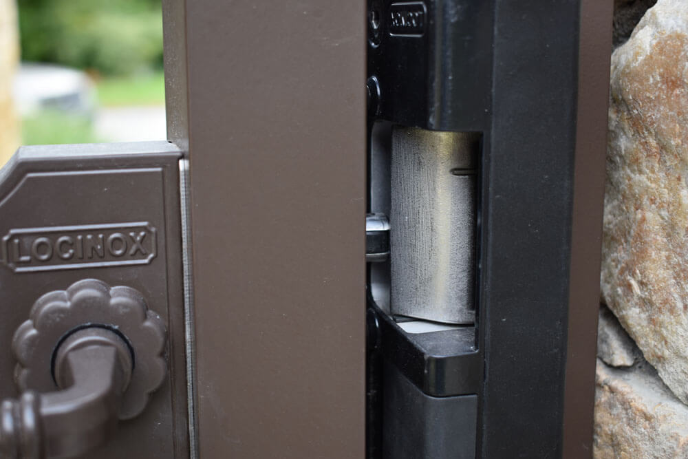 Electronic Strike Latch Attached To Security Gate