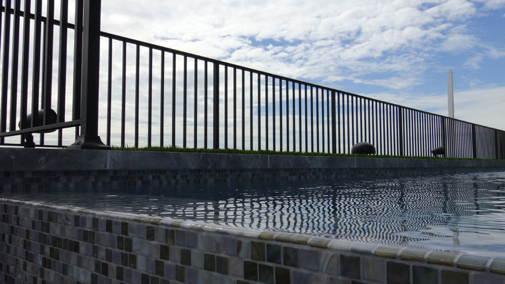 Aluminum Railing Between Pool and Sand Dunes
