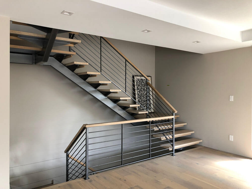 Iron Stair Structure with Railing and Wooden Caprail